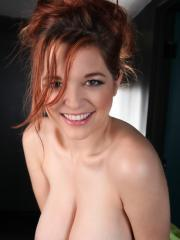 Sexy busty redhead Tessa Fowler shows off her huge natural tits
