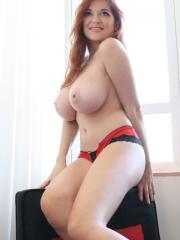 Busty redhead babe Tessa Fowler gives you a taste of her huge all natural 32GGs