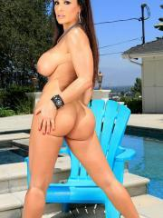 Busty Lisa Ann strips for you by the pool