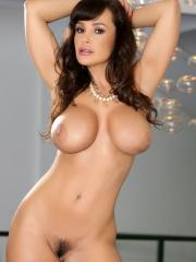 Busty babe LIsa Ann poses for you in her stockings