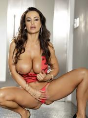 Busty MILF Lisa Ann strips off her pink zebra print dress to expose her busty body