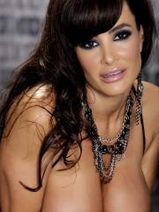 Busty milf Lisa Ann strips down to her boots and teaes with her big tits and wet pussy