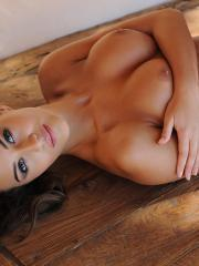 Brunette hottie Chloe Goodman gets topless and rolsl around on the coffee table