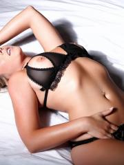 Beautiful blonde Melissa Debling reveals her soft round boobs in black lingerie