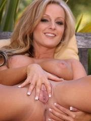 Pictures of Melissa XoXo rubbing her wet pussy outdoors