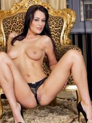 Brunette hottie Dana Weyron strips off her thong and touches her pussy