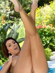 Dylan Ryder sits down on the ground to please her pussy