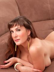 Busty girl Valory Irene plays with her big boobs on the couch