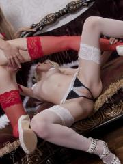Milena D and Nika D teasing and seducing each other in sexy lingeri and thigh-high stockings
