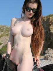 Emily Bloom enjoys some nude horse back riding on the beach