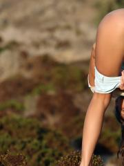 Beautiful teen Masha E shows off her body in the middle of nowhere