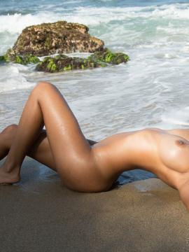 Busty latina Kendra Roll strips off her bikini and masturbates on a tropical beach