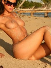 "Brunette hottie Melisa A displays her tight body in ""Caribbean paradise"""