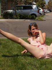 Hot teen April Grantham shows off her flexibility at a park