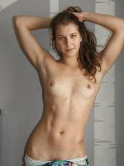Brunette coed Yulia Sosnova shows you her dance moves in the nude